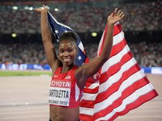 American Tianna Bartoletta celebrates after winning the gold medal in the long jump at the IAAF World Championships in Beijing.  Kirby Lee, USA TODAY Sports