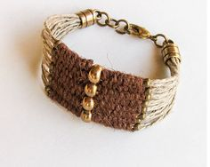 Womens hemp beaded bracelet, made of hand woven brown jute and brass beads, on natural hemp cord. Natural, earthy colors with a touch of shine for this multistrand boho cuff bracelet. You can wear it alone, or layered with other bracelets for a trendy, stylish look.  ♥Bracelet measures 7 (18cm) and closes with a brass lobster clasp.  Width: 1 1/4 (3.2 cm).  ★★★see my other bohemian jewelry: https://www.etsy.com/shop/myTotalHandMade?section_id=15106147&ref...