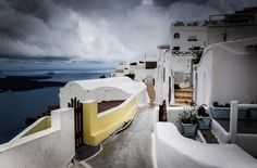 Winter in Santorini: watching the storm roll on Santorini Greece, Athens Greece, Snow In Greece, Seasons In The Sun, Greek Islands, Building A House, Organizing, Buildings, Around The Worlds