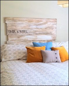 My cousin Emily's GREAT headboard she and her hubby made from scrap wood in the garage, white paint, and Briwax! Great idea :)
