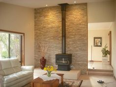 Stone wall behind wood stove