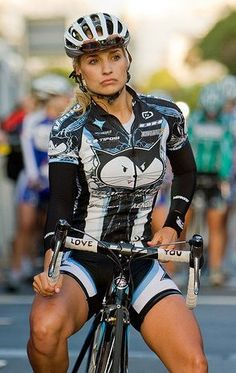 Another female cyclist, gotta love the legs!