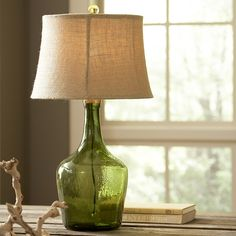 Lawrence Table Lamp | With stylings of a green art-glass vase, this table lamp features a classic jug-like shape topped by a soft linen shade. A green glass coordinating finial completes the look.