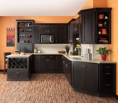 Great contemporary kitchen, love the dark cabinets, with the pops of orange color, and mix of open storage with closed cabinets.