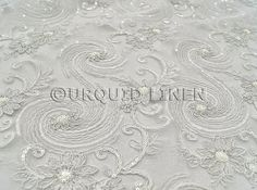 Introducing Urquid Linens elegant Jasmine Lace fabric in White... a beautiful choice of linen for any weddings, bridal parties, and special events. Shop our large inventory of bridal lace fabrics.   ♥ FABRIC DESCRIPTION:  This beautiful fabric is made on a sheer base with an exquisite sequined floral embroidery throughout. The fabric width is approximately 54 Wide and is offered in a White color.   ♥ PURCHASING INFORMATION:  This fabric is sold by the yard and each Qty you enter will…