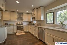 Traditional Kitchen with High ceiling, Hardwood floors, U-shaped, European Cabinets, Undermount sink, Flush, Subway Tile