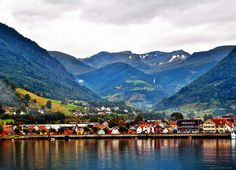 Norwegian village in the fjords.  I wish we painted our houses colors too. Theres no place like home. NORWAY