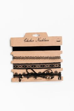 """Choker necklace set featuring 4 different designs. Each measures approx. 12"""" in length + a gold chain extender. Lobster clasp closure."""
