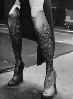 AMQ Savage Beauty - London McQueen ('99) prosthetic legs carved from ash for Aimee Mullins. Photograph by ANNE DENIAU