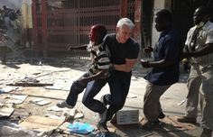 throughsanaseyes:  harvey-swick: flowers-without-reason:  caesoxfan04:  Anderson Cooper saving a boy in Haiti during a shooting. A slab of concrete was dropped of the boys head.  Anderson fucking Cooper, everyone.  Some journalists like to be strictly observers. they don't intervene, they don't participate. they just document what they see, even if what they see is terrible. But the way I see it, journalists don't exist in a vacuum. They are human beings, living and working in a very human e...
