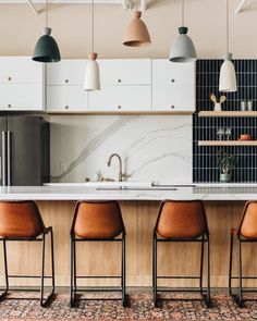 Varying pastel shades of pendant lights in this kitchen