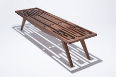 The Eastside Bench - A handcrafted solid American walnut bench with no hardware made by Jason Fierst of Fierst Design.