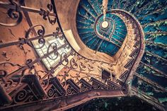 The 40 Most Breathtaking Abandoned Places In The World. This Gave Me Chills!Blue spiral staircase in a European castle