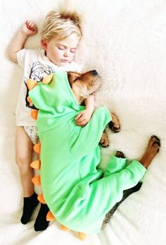 I love what this mother has done, documenting her son and dog's daily naps together. It's as though they were litter mates!