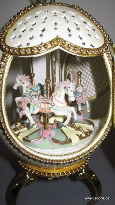 Musical wind-up carousel inside an ostrich egg - intricate and beautiful.