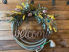 Excited to share this item from my #etsy shop: Ruffle My Feathers (Peacock) **MULTIPLE DESIGNS** Floral Rope Wreath , Western Rope Wreath, Wreath, Lariat Wreath, Cowboy Crafts, Western Crafts, Country Western Decor, Barbed Wire Art, Barbed Wire Wreath, Rope Crafts, Diy Crafts, Garden Hose Wreath, Western Wreaths