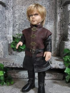 About Tyrion Lannister: This little guy was made from a Tonner Lucy Pevensie doll, and had extensive face and body work.  The face is by Tracy Weston and I did the costume and styling.