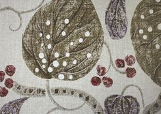 Astasia Fabric A floral printed fabric featuring green and violet leaves, pale stems and red berries on an light beige background.