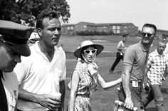 Arnold Palmer walking at the Masters in 1962.