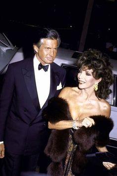Joan Collins escorted by George Hamilton