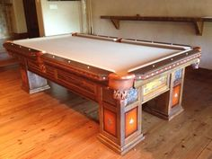 Custom Pool table by Western Heritage Furniture.  Reclaimed barnwood with leather, copper, and turquoise accents.