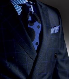 Plaid pattern suit, striped shirt, dotted tie - different patterns go well together when done with contrasting sizes