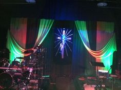Draped fabric and lights create an interesting pattern and texture for this simple worship stage design