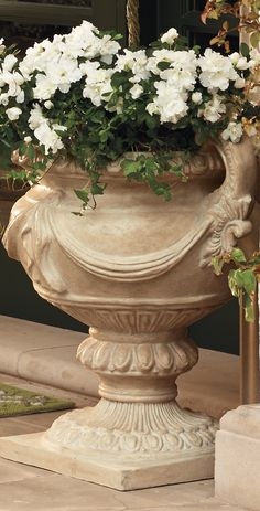 With dimensional ribbon festoons and intricately detailed, scrolled handles, the exclusive Triumph Estate Urn bespeaks the sophistication of Classical antiquity.