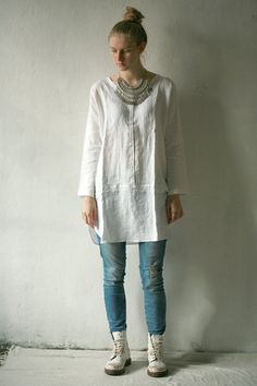 White linen tunic with long sleeves with metal snap closure on front