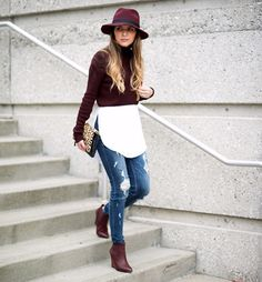Burgundy wide-brim hat, turtleneck cropped sweater, white blouse, distressed jeans, and burgundy ankle boot. Perfect winter outfit!