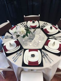 A formal, elegant but simple table for a dinner party or wedding! The black chargers pop off the white linen and add so much dimension especially with the red napkins! We love this table setting for fall or winter! Black Napkins, Silver Table, Dinner Sets, Table And Chairs, Showroom, Wedding Stuff, Table Settings, Pop, Elegant