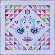 "This sweet quilt is inspired by and makes use of my newest fabric collection for 2015, ""FlutterBerry"".What a cute way to introduce a Swan theme to the nursery or any child's room.  You could easily increase or decrease the border width to make this quilt a little smaller or a little larger.This pattern is suitable for all skill levels.Completed size:  Measures approx 48.5"" x 48.5""Patterns contain the templates and full step-by-step instructions to create your own ""Sweet Little Swans"" quilt."