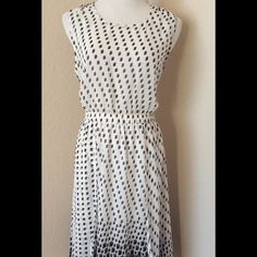 White black sleeveless midi summer dress size M This dress is sheer in the chest, the skirt is lined. It fits US woman size 10 Soft polyester fabric, flowing skirt, two front panels in the skirt, see photo, one button in the back. waste has elastic in it, it stretches, to 30-33 inches. Forever 21 Dresses Midi