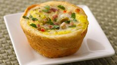 Individual Italian-inspired quiche cups are surrounded by a flaky crust made easily with Pillsbury® crescent rounds.
