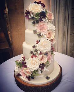 Autumnal Floral Cascade Wedding Cake by Samantha Tempest - http://cakesdecor.com/cakes/261794-autumnal-floral-cascade-wedding-cake