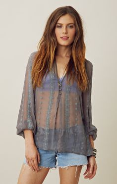 It may be a grey and stormy New York day so why not pair ZOA's billowy silk lace blouse with cutoffs and vintage boots! Take your color cue from the the grey sky's outside and look effortless inside..xxx