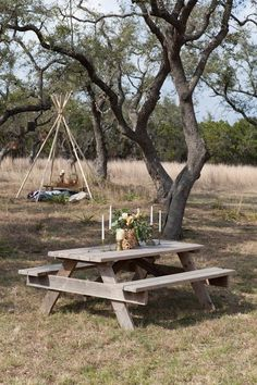 Perfect outdoor wedding boho / vintage vibe! Picnic table and teepee!
