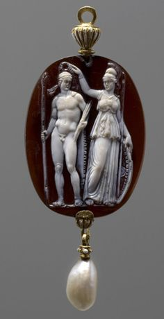 Cameo and pearl pendant.