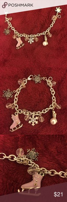 Holiday Charm Bracelet Just in time for the holiday season! Gorgeous silver charm bracelet. Comes with an ice skate, snowman, several snowflake charms! Jewelry Bracelets