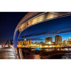 """The new St. Patrick's Bridge, which opened today, is a beauty! Took this shot at dusk. Go see it for yourself! #capturecalgary #eastvillageyyc #calgary #alberta #explorealberta #capturecalgaryatnight #bridge #canon #SkippingStone #iamdowntown #yycbike #yycwalk""  Instagram photo by klaszus"