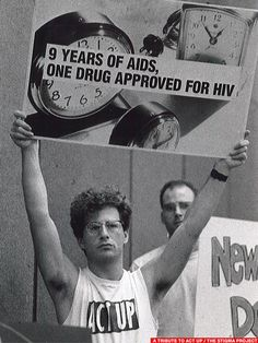 1989.  A member of Act Up/NY holds up a sign at the open hearings on new HIV/AIDS drugs in Bethesda, MD. About 43 members of the organization participated in the silent protest. (Photo by Patsy Lynch)