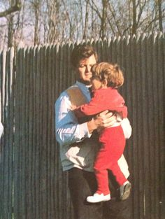 thedreamthatneverdied:   April 7, 1963:Ted Kennedy lifting his nephew John at the Camp David skeet range.   I always loved this one! Sweeties.