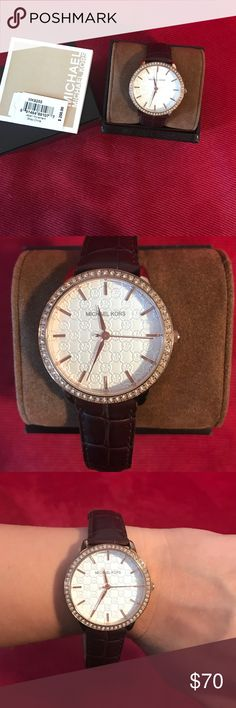 Michael Kors watch Michael Kors watch with brown leather band ( not original band, replaced for different color but band is genuine Italian calfskin leather). Watch is in perfect condition with original box and price tag. Michael Kors Accessories Watches