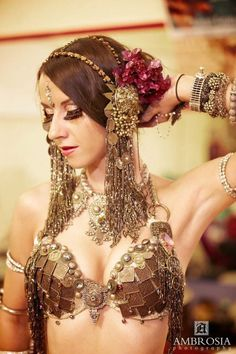 Cabaret belly dance, with a beautiful metal-trimmed bra and headdress.