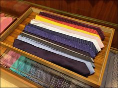 Necktie Windrows in Tray Main Tie Rack, Retail Merchandising, Window Ideas, Neckties, Bridal Outfits, Trays, Fathers, Purpose, Men's Fashion