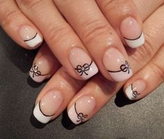 Pink and black bow French tip. Draw on thin lacy bows underneath your French tips to make them look even prettier.