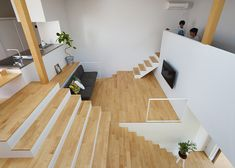 House in Hakusan by FujiwaraMuro Architects, in Ishikawa, Japan. The stairs expand the dimension of the house vertically. They emphasize the three-dimensional circulation of the house
