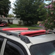 Roof pads made for my standup paddleboard for transport.  DIY - total cost about $8 2 pool noodles Decent grade rope 4 caribinger hooks