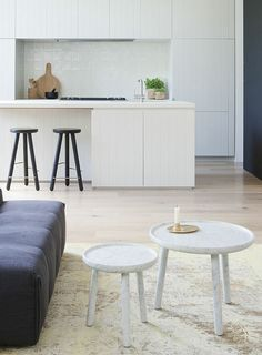 Love the combination of dark wood stools and simple white kitchen (Robson Rak | Made by Cohen | estmagazine)