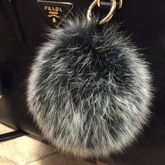Trending Chic Real Fox Fur Ball for Luxury Purse Back In Stock!  super Chic & Fluffy Real Fox Fur Ball for your luxury handbag. This is a fashion statement! One accessory that adds so much personality to all your handbags, versatile, premium quality made in Korea, comes with gold buckle. Please see pictures for size comparison (purse not included). Real fox fur ball sells $300-400 at designer stores, this is the best alternative you will find :) I also have other colors available…